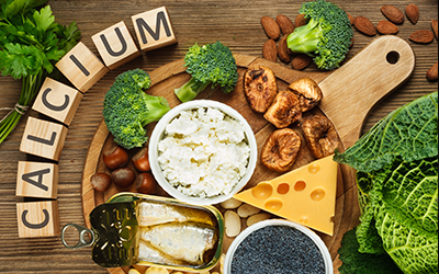 Picture of various foods with calcium in them such as milk, and cheeses